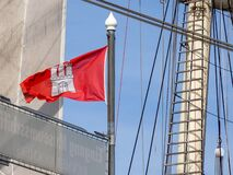 At the end of the flagpole the red flag of Hamburg is waving