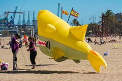 End of flight for the shark. VALENCIA, SPAIN. May 12, 2019: Kite International Festival. Malvarrosa beach. Contest with acrobatic and choreographic flights. The royalty free stock photos