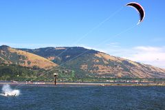 The end of a glide surf. I was walking near the banks of the Columbia River when this glider came screeching on the water to stop, while still fighting the wind Royalty Free Stock Images