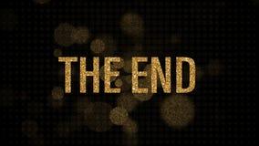 The End golden text animation with gold bokeh burst and spark background. 4K 3D golden glitter light blurs on black.