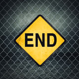 End Grunge Yellow Warning Sign on Chainlink Fence Stock Photography
