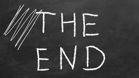 The End. Hand drawing  text `THE END` on blackboard royalty free illustration