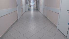 At the end of the hospital corridor a woman stock video footage