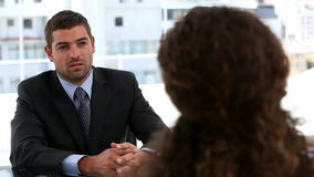 End of an interview between two businesspeople stock footage