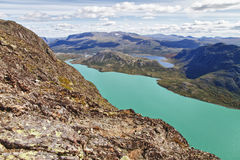The end of the lake Gjende in Norway. Start of the famous Bessegen hike in Jotunheim National Park, Norway royalty free stock images