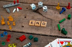 `End` made from Scrabble game letters. Risk, Battleship pieces, Monopoly, Settler of Catan and other game pieces royalty free stock photo
