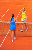 End of the match - Sorana Cirstea and Ana Ivanovic. Sorana Cirstea (winner) and Ana Ivanovic at the end of the first game between Romania and Serbia women tennis Royalty Free Stock Photo