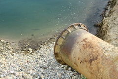 End of metal sewer pipe Royalty Free Stock Photography