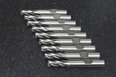 End mill tool CNC array stack on granite table Stock Image