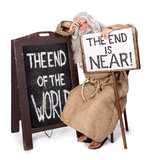 The end is near. Visionary with a sign of the end of the world Royalty Free Stock Photos