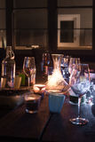 End of the night, empty wine glasses on outdoor table Royalty Free Stock Photography