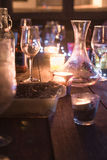 End of the night, empty wine glasses on outdoor table Royalty Free Stock Photos