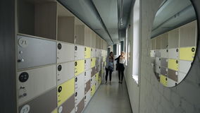 Free End Of Day In Office, Women Can Take Personal Belongings From Lockers. Stock Photography - 74238532