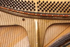 The strings of a musical instrument. End an old piano, which has left only the strings royalty free stock photos