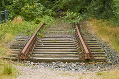 The End. Old railway rails end in the countryside Stock Image