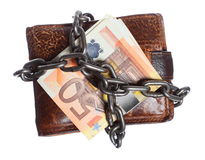 End of personal spending.  Wallet euro banknote in chain. End of personal spending. Wallet euro banknote currency in chain isolated on white Royalty Free Stock Photos