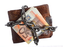 End of personal spending.  Wallet euro banknote in chain. End of personal spending. Wallet euro banknote currency in chain isolated on white Royalty Free Stock Photo