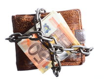 End of personal spending.  Wallet euro banknote in chain. End of personal spending. Wallet euro banknote currency in chain isolated on white Royalty Free Stock Photography