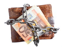 End of personal spending.  Wallet euro banknote in chain. End of personal spending. Wallet euro banknote currency in chain isolated on white Stock Photo