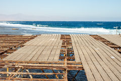 End of the pier. Sea and sky background Royalty Free Stock Photography