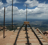 End of Pikes Peak railway. A view of the end of Pike's Peak Cog Railway where the last few feet hang dangerously unsupported over the edge of the mountain Royalty Free Stock Image