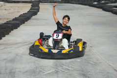 End of race. Young happy woman the winner of the karting race Stock Photography