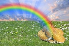End of rainbow pot of gold treasure. Concept photo of gold coins treasure found at end of rainbow Royalty Free Stock Photos