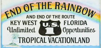 End of The Rainbow Sign Key West Florida. End of the Rainbow sign marking the end of U.S. Highway 1 in Key West, Florida, USA royalty free stock images