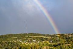 End of a rainbow in the sky stock photos