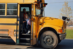 Young girl on school bus Stock Photography