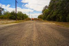 End of the road. An overgrown road under blue skies Stock Photo