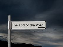 The end of the road, sign over dark, gloomhy cloud sky background. Concept, politics,, Brexit etc. royalty free stock images
