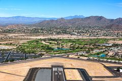 End of Runway Landscape. Aerial view of the end of the runway with vintage warplane on approach Stock Photo