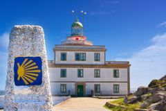 Saint James Way sign and lighthouse of Finisterre. End of Saint James Way sign and lighthouse of Finisterre in Galicia Spain photomount stock image