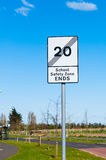 'End of school safety zone' Sign on blue background Stock Photos