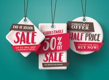 End of season Christmas sale vector set of red sale tags hanging with half price text. And with origami paper style for holiday discount promotion. Vector Royalty Free Stock Photo