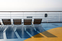 End of season - 2. Deck chairs on the deck of a cruise ship in the fall Royalty Free Stock Photo