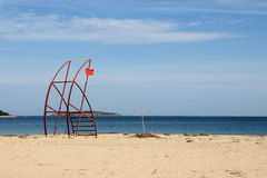 End of season - 1. Red flag on the tower on deserted beach in Bulgaria Royalty Free Stock Photos