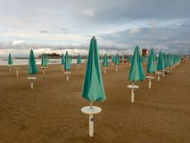 End of the season Rimini italy. Sun umbrellas. End of the season in Rimini Italy. The time of storms Royalty Free Stock Photos