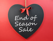 End of Season Sale on Heart Blackboard. End of Season Sale sign message on heart blackboard against a red background, for the end of Valentines Day or other Stock Photo
