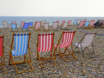 Deck chairs on beach Royalty Free Stock Photos