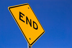 The end sign with brilliant blue skies. The End road sign in the California sun Royalty Free Stock Photos