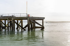 End of small jetty or pier. And of jetty at Aberdyfi, Wales, United Kingdom with sea behind royalty free stock images