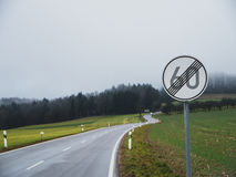 End of speed limit with curvy road. Sign indicating end of speed limit with curvy road in Germany Royalty Free Stock Image