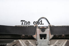 End of the story. The end words written on a paper sheet from a typewriter royalty free stock image