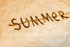End of summer. Cross out word on crumbled paper texture yellow toned Stock Image