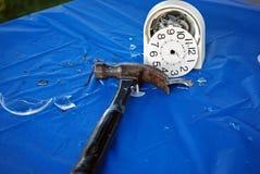 hammer with smashed alarm clock Stock Image