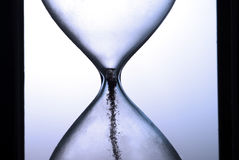 End of times on hourglass closeup. Deadline  on hourglass closeup with last grains Stock Images