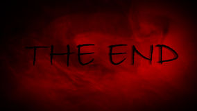 The end title. With scary font and red smoke in the background, fades and zooms in with alpha cannel in 4k resolution vector illustration