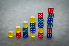 End to end stack of red dice Stock Photography